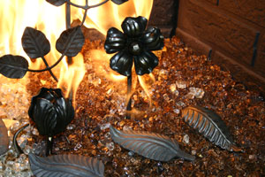 Metal decorative objects for the fireplace glass
